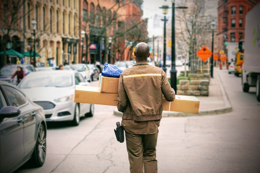 Deliveryman with parcels retail and logistics